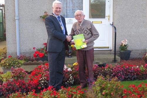 Provost Joe Wallace presents Jack Davidson with award